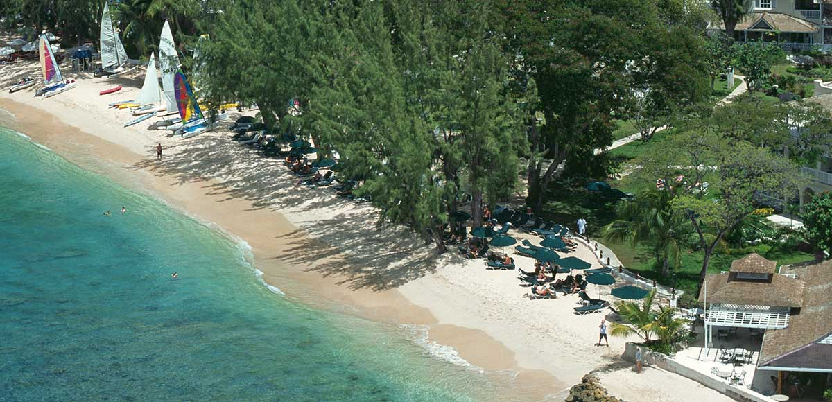 The Coral Reef Club is located directly on the beach